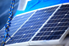 Solar panels in sailboat. Renewable eco energy. Solar charging batteries aboard a sail boat. Photovoltaic panels renewable eco energy concept Royalty Free Stock Image