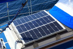Solar panels in sailboat. Renewable eco energy. Solar charging batteries aboard a sail boat. Photovoltaic panels renewable eco energy concept Stock Image