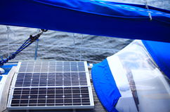 Solar panels in sailboat. Renewable eco energy. Solar charging batteries aboard a sail boat. Photovoltaic panels renewable eco energy concept Royalty Free Stock Images