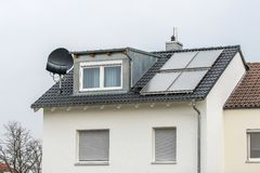 Solar panels SAT TV. Old building energy re-manufacturing with solar panels stock images