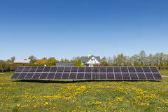 Solar panels. A set of dark blue solar panels in a grass field Royalty Free Stock Photo