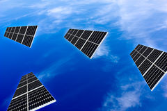 Solar panels in the sky. Solar panels flying in the sky over the clouds Stock Images