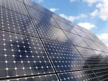 Solar panels against blue skies. Close up of patterns on solar panels against blue skies on sunny day Stock Images