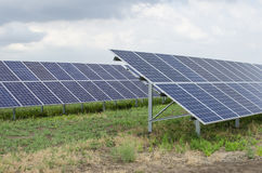 Solar panels on the sky background Stock Images
