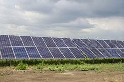Solar panels on the sky background Royalty Free Stock Photo