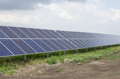Solar panels on the sky background Stock Photography