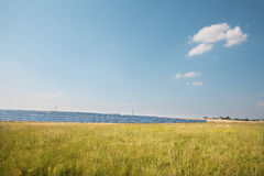 Solar panels and the sky - landscape. Solar panels and the sky in the summer landscape Royalty Free Stock Photography