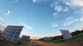 Solar panels on the sky. Original photo fish eye Royalty Free Stock Images