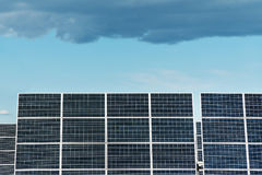 Solar panels and sky. Solar panels of the power plant and the sky, covered with clouds Stock Photography