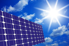 Solar panels with sky and sun. Image of solar panels - clean energy source on the background of sky and bright sun Stock Photo
