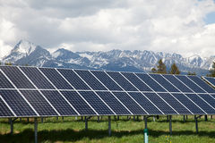 Solar panels with snowy mountains in the background Stock Image