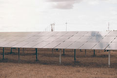 Solar panels solar cell in solar farm with sun lighting. Stock Images