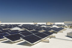 Solar Panels At Solar Power Plant. Against clear sky Royalty Free Stock Photo