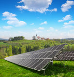 Solar panels in spring landscape. Royalty Free Stock Photo