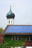 Solar panels and steeple Stock Photography