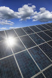 Solar panels with the summer sun reflected Royalty Free Stock Photo