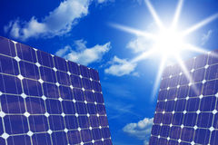 Solar panels with sun Stock Photos