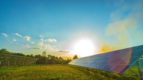 Solar panels and sun, panoramic time-lapse stock footage