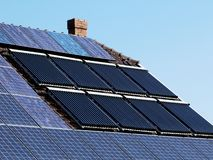 Solar panels and sun-powered water heater pipes stock image