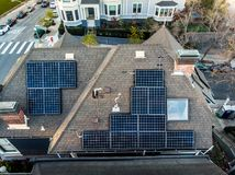 Solar panels system on the house roof in the city. Technology for alternative energy concept Stock Image