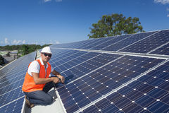 Solar panels with technician stock images