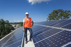 Solar panels with technician royalty free stock photos