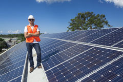 Solar panels with technician Royalty Free Stock Photos