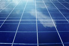 Solar panels texture with reflect of cloud. Solar panels texture with reflect of white cloud royalty free stock photography