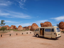 Campervan Parked at Devils Marbles Stock Images