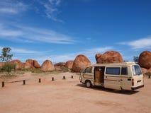 Campervan Parked at Devils Marbles. Campervan Parked at the Devils Marbles in Australia stock images