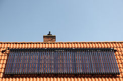 Solar panels on tiled roof Stock Photos