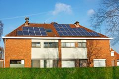 Solar panels on a tiled roof. Solar panels on the roof two-story private houses Stock Image