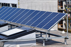 Solar panels on the top of a building Royalty Free Stock Photography