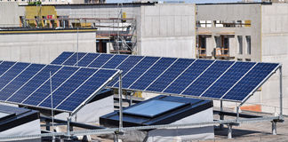 Solar panels on the top of a building. In the city Stock Photo