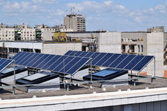 Solar panels on the top of a building Stock Images
