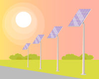 Solar Panels Turned to Shining Sun along Road Royalty Free Stock Images