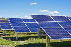 Solar panels under blue sky. Solar panels on on beautiful summer day Royalty Free Stock Photography