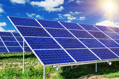 Solar panels under blue sky Stock Photos