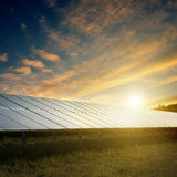 Solar panels under sky on sunset Royalty Free Stock Photo