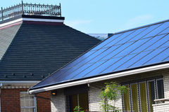 Solar panels in Urban neighborhood Royalty Free Stock Photography