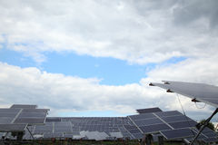 Solar panels used to generate electricity. From sunlight against clouds and sky. In selected focus Royalty Free Stock Image