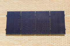 Solar panels on the wall of a building stock images