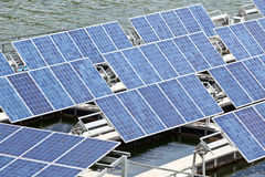 Solar panels  on the water. Royalty Free Stock Photo