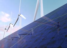 Solar panels and wind generators against sunset sky Stock Images