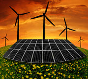 Solar panels and wind turbine. In the setting sun Royalty Free Stock Image