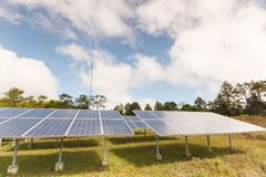 Solar panels and wind turbine in contryside. Royalty Free Stock Photography