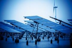 Solar panels and wind turbine. Stock Photo