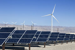 Solar Panels and Wind Turbine Power Stock Images