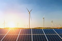 Solar panels and wind turbine with sunset on the hill. concept i. Dea clean energy stock photo