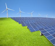 Solar panels and wind turbines Royalty Free Stock Images